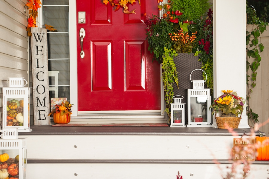 Festive autumn porch outside of home decorated after homeowner scheduled their fall HVAC Maintenance