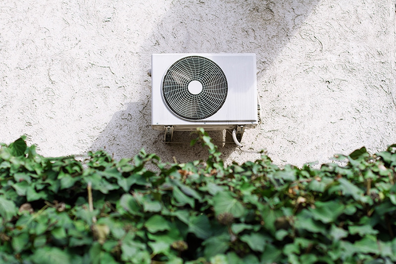 An air conditioning unit outside of home showing how a central air conditioner can cool your home.